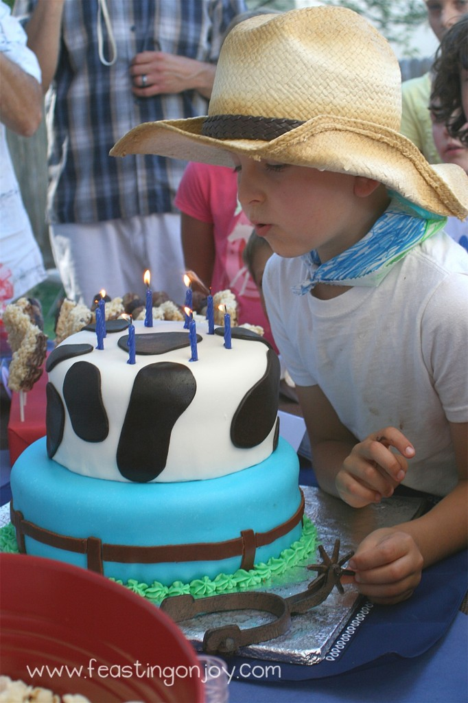 Cowboy Party Cake Blowing out candles